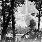 Trees and Cabin with Yosemite Falls in Background